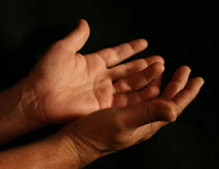 Two hands with dark background